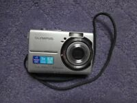 Olympus FE-190 digital camera with 3x optical zoom and 6.0 megapixels and lots of extras