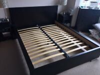 Used Black Wood King Sized Bed available for collection only.