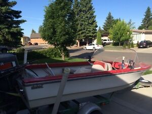 16 foot Motor Boat. 4 seater. Includes trailer