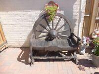 Antique cart wheel garden bench