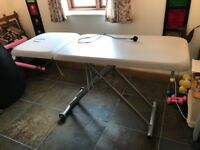 Massage table. Electric up/down operation. Good condition.