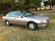 1993 Ford Falcon EBII GLi Gold 4 Speed Automatic Sedan Applethorpe Southern Downs Preview