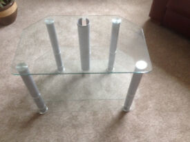 Glass TV corner unit with two shelves . Excellent condition.