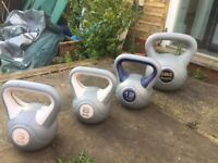 4 kettlebells of various weights for sale