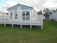 Pre owned static caravan lodge holiday home with decking sited in Hunstanton Norfolk - Not Searles