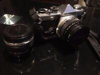 Collectors Item Reel-Camera Olympus OM-2 with medium carry case.