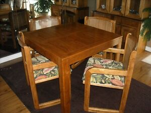 Table with 4 Arm Chairs and Lighted Cabinet for Sale