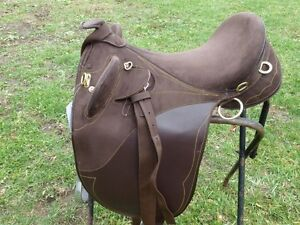 NEW AUSSIE SADDLE WITH HORN.