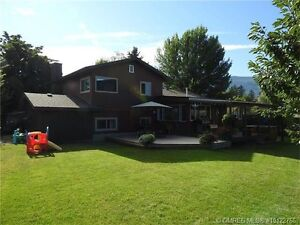 New listing in Coldstream: 1/3 acre and backs onto farm