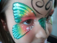 face painting at Christmas party with Mai Art Expressions