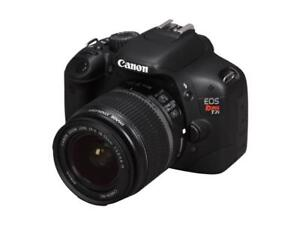 Canon Rebel T2i camera with 3 lenses