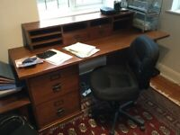 Large office desk with swivel chair on wheels