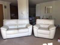 WHITE TWO-SEATER LEATHER SETTEE AND MATCHING CHAIR