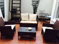 GORGEOUS BROWN RATTAN OUTDOOR SETTING WITH TABLE AND ARMCHAIRS AND CUSHION