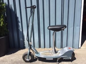 electric razor scooter with seat