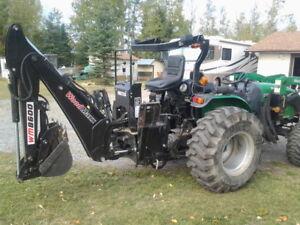 43 HP, 4 wheel drive tractor, 8 ft backhoe, rototiller , snow bl