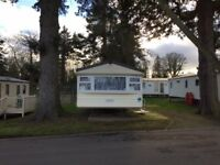 FOUR BED 10 BERTH CARAVAN TO RENT HAGGERTSON CASTLE