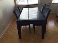 Dark wood dining table w/ chairs