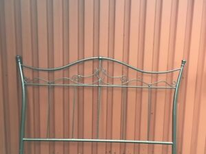Queen-size metal bed frame and headboard.