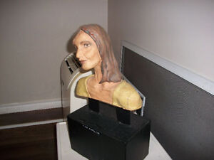 Ceramic bust on metal stand