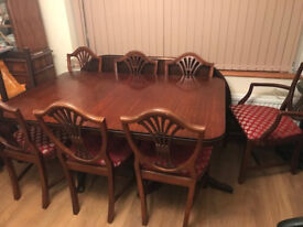 SOLID WOOD, MAHOGANY EXTENDING DINING TABLE AND 8 CHAIRS.TOGETHER FOR ONLY £185 OR SEPARATELY