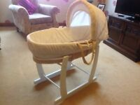 Moses basket complete with rocking stand.