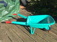 Toddler's green plastic garden Bosch wheelbarrow