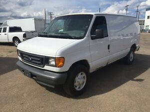 2005 FORD E-250 CARGO - FULL SHELVING UNIT INCLUDING PARTITION