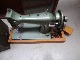 vintage Jones manual sewing machine with case