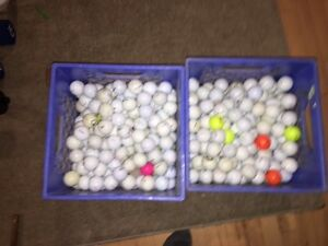 Two lots of 225 golf balls