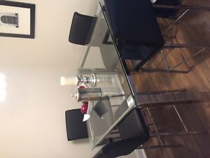 Like New Beautiful Glass Table with four Chairs