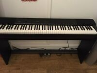 A black Casio Privia PX-150 digital piano for sale £250 Cardiff