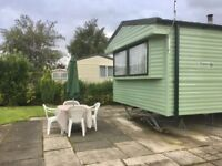 Fantastic starter two bedroom caravan on great pitch