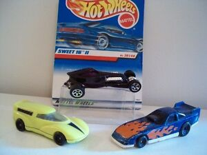 three old Hot Wheels cars