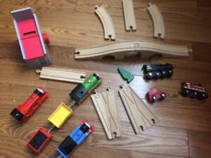 Wooden Train Track Set with several battery operated trains