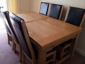 Solid Oak Dining Table and Six Black Leather Chairs (also two black faux leather chairs if required)