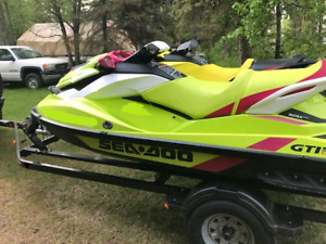 2 -2 year old seadoos and trailer