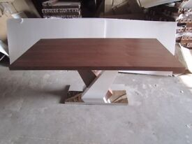 Brand new dining table sealed with stainless steel base