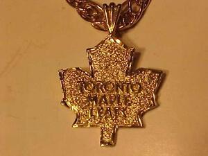 #3164-OFFICIAL N H L TORONTO MAPLE LEAF PENDANT-14K-plus 10k Italian made Necklace-total 8.0 gms-FREE SHIPPING CANADA