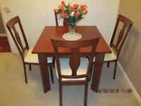 Dining room table and 4 chairs finished in Mahogany