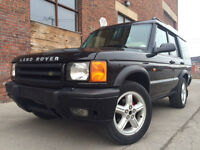 1999 Land Rover Discovery SE7 - Only 166KM.  Black on tan.