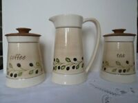 Set of Tea and coffee storage jars and matching milk jug.