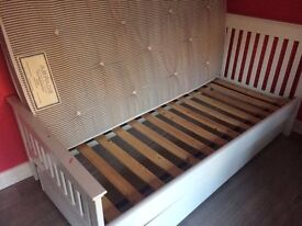 Single white wooden 'Aspace' bed with trukle bed and mattress underneath