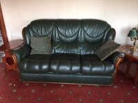 Contemporary three-seater leather settee, two matching chairs and a stool.