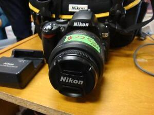 Nikon D60 DSLR Camera with 18-55mm f/3.5-5.6G Auto Focus-S Nikkor Zoom Lens with Bag and Charger