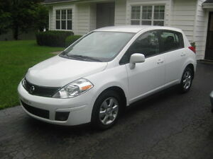 2011 Nissan Versa 1.8 SL Hatchback WITH 8 RIMS AND 8 TIRES