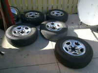 5 GMC Sierra 16 inch wheels and tires $375 OR BEST OFFER