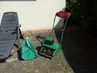 Electric Cylinder Lawn Mower works okay includes grass box.
