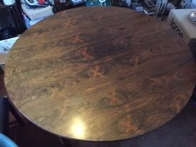 Stunnung round walnut dining room table