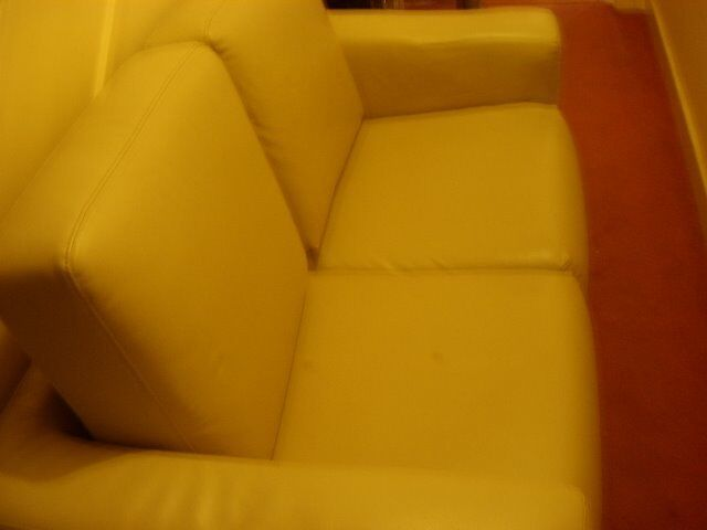 CREAM TWO SEATER LEATHER SOFA FREE - CAN DELIVER LOCALLY FOR COST OF FUEL